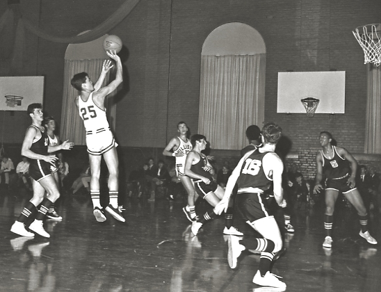 Basketball -- not the 9th grade team! -- in the Old Gym, 1968. Mike Timm '68 (#25) and Cary Jubinville '68. Photo by Paul Wainwright '68.