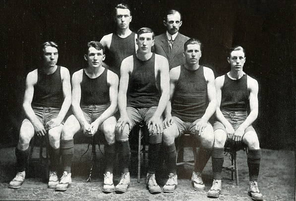The undefeated team of 1910, Lynch towering over his teammates (1910 Log)