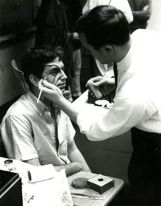 Richard Gregory applying stage makeup to Rogelio Novey