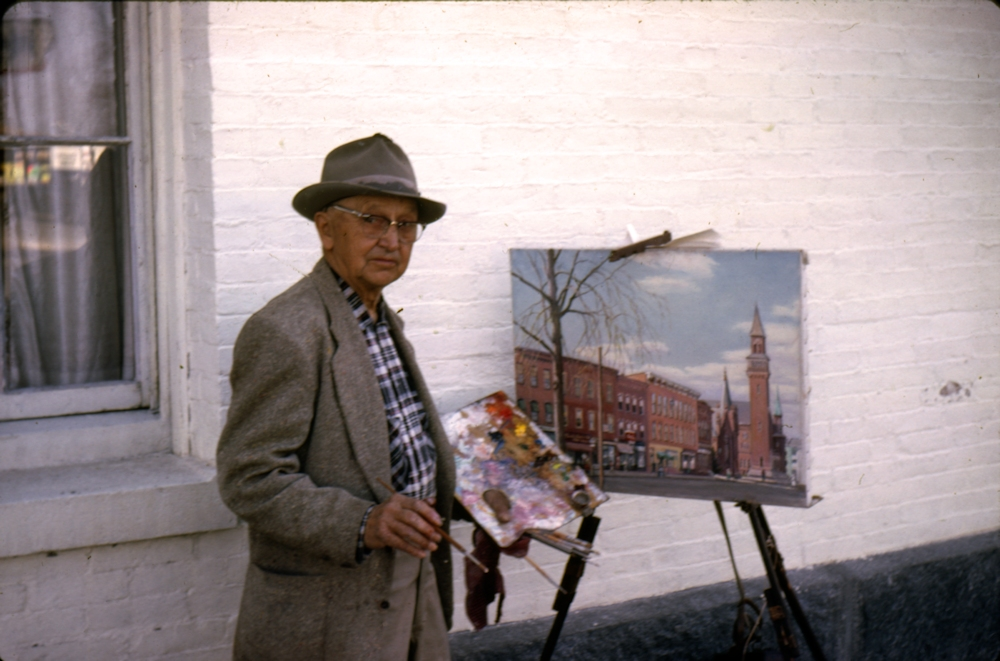 Albert Kiesling next to the Easthampton Congregational Church, working on a view of Shop Row.