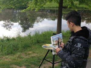 Sitai Chen painting en plein air at 6:00 AM.