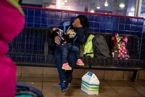 SAN ANTONIO, TEXAS - M.P., 21, waits with her 2 year old daughter at the San Antonio Greyhound Bus Station for a bus to Houston where she has family. November 10, 2015: Asylum-seeking women, most of them with children, have been bussed to San Antonio's central bus station from Dilley Residential Center or Karnes County Residential Center. Organizations including the Interfaith Welcome Coalition and the Red Cross greet the majority of women at the Greyhound Bus Station and assist the women in traveling on or offer temporary shelter in San Antonio. From here, many will transport to family members throughout the country. Others will go to Raices House, a shelter in San Antonio, where they will be assisted. Most women are forced to wear electronic ankle monitors. Ilana Panich-Linsman for The New York Times