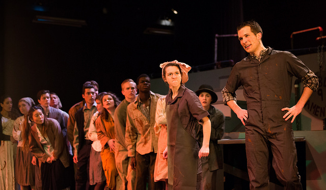 Oliver as Bobby Strong with the company of Urinetown, Spring 2014