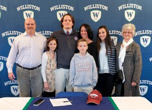 Brian Sullivan and family members at a signing on campus