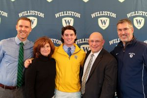 Ian Ostberg with parents Carol and Robert Osberg and coach Matthew Sawyer and Athletic Director Mark Conroy
