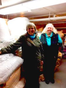 Williston's Ann Truehart and Easthampton Community Center Executive Director Robin Bialecki with a lot of bedding
