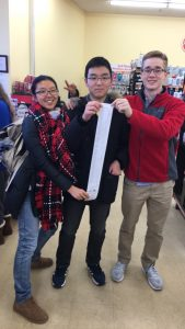 Sophomores Glede Wang, Simon Kim, and Robby Hill, shopped for food to donate before winter break.